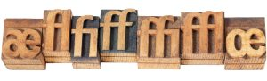 Row of ligatures in vintage wood type